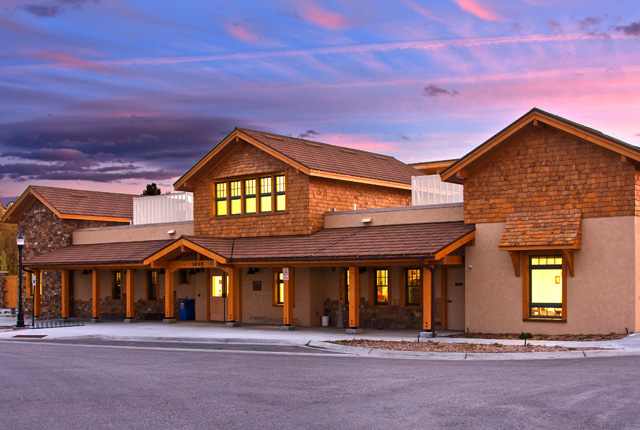 Image of a two story building at dusk